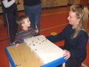 "Parents helped their children develop motor skills at the Parents as Teachers ""Romp or Rumble"" Saturday Feb. 19 at Lansing Elementary School."