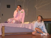 "Eighth grader Molly Kane, left, and seventh grader Kayla Wiggins rehearse a scene from the Lansing Middle School production ""Welcome to the Haunted House"" on Monday Feb. 28."