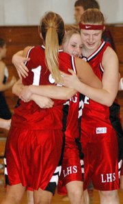 Freshman Amanda Darrow, middle, and junior Amanda Radovich, right, hugged senior Emily Goodlin after the game and thanked her for her leadership.