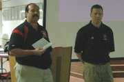 Bill Pekarek, left, Lansing High football coach, introduces Chris Douglas, head football coach at Southwestern College, as one of the guest speakers Saturday at the coaches' clinic.