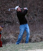Chris Nelson, Lansing High senior golfer, fires a shot from the rough Monday at the Mill Valley Invitational.