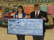 "Jodi Morris-Neville, a Wal-Mart assistant manager, presented a check for $2,000 to Mike Howell, senior vice commander for Lansing VFW on Tuesday. ""Wal-Mart felt giving a donation was good for the community,"" Morris-Neville said. She said groups must apply for donations. Applications can be found online, she said. Howell said the money would be added to funds that are used to help veterans."