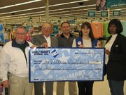 Members of the 2005 Leavenworth County Veterans Day Parade received a donation of $1,000 from Wal-Mart Tuesday. From left are John Carroll, committee member; Joe Lauber, 2005 parade chairman; Jerry Hansen, committee member; Jodi Morris-Neville, Wal-Mart assistant manager; and Diane Smith, secretary of the parade committee.