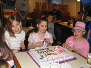 Darian Bequette, Brooke Mortsolf and Jordan Counts at Brooke and Taylor Mortsolf's 8th birthday party at Pizza Hut.