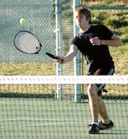 Senior Chris Hancock drops a shot over the net Friday at the Mill Valley Invitational.