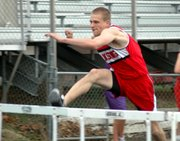 Senior Ethan Nalker races to an early lead in his 110-meter hurdles prelim.
