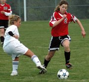 Sophomore Bianca Manago blows past a De Soto defender on her way to logging the game-winning assist Thursday.