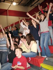 Eighth-graders cheered when they learned they had achieved the standard of excellence and earned a day off at a pep rally Tuesday in the LMS gym.