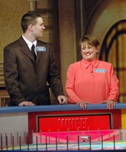 "Sean Willcott and his mother, Eileen Willcott, of rural Leavenworth, await their turn at the wheel before a special taping of ""Wheel of Fortune"" in Kansas City. The Willcotts and Lansing resident Alison Dessert were contestants this weekend when 15 ""Wheel of Fortune"" shows were taped in Kansas City's Bartle Hall. The shows will air in May."