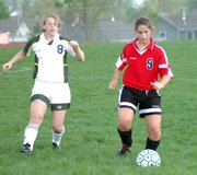 Sophomore Michaela Bristow stole the ball from a Basehor-Linwood forward on Wednesday during the Lions' 7-0 victory.