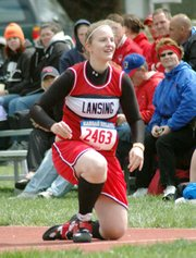 LHS junior Amanda Radovich flashes a smile in frustration after scratching on her first throw in the javelin at the KU Relays.