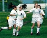 Andrea Young, Julie Bray and Nicole Radcliffe celebrate the first goal of the match against Harmon. Seven other goals followed Bray's initial score
