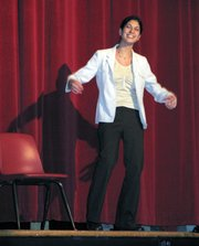 "Katie Lowe, Lansing High School senior, performs her humorous solo ""medea"" at Forensics and Drama Night Monday at Lansing Intermediate School."