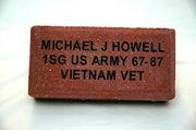 Bricks that can be inscribed like this one are being sold to help raise funds for the Lansing Memorial for Veterans.