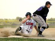 Senior John Tytla slid safely into third base for a stolen base against Piper.