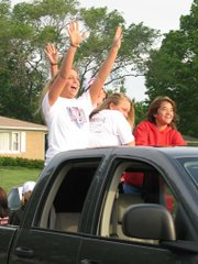 Lansing High School seniors are busy as their school days wind down and graduation approaches. Wednesday morning, they participated in the annual Senior Parade on the streets around the high school. From left, Emily Goodlin, Melissa Casto and Monique Richardson participate in the parade from the back of a pickup truck.