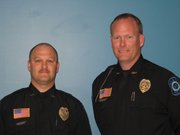 Lansing Police Officer of the Year Aaron Wilson and Chief Steve Wayman