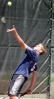 Senior Chris Hancock prepares to serve during he and Chris Bristow's first doubles match at the Class 5A state tennis tournament.