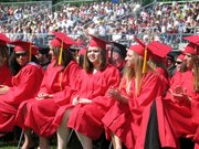 Lansing High School seniors wait to receive their diplomas