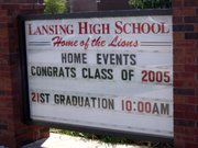 A sign outside Lansing High School reminds everyone that Saturday is Graduation Day for LHS seniors.
