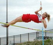 Senior Sara Eustice clears the bar in the pole vault. Eustice placed fourth at state.