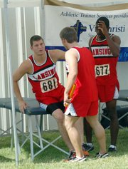 Lance Fink and E.J. Corinealdi help Jeff Slater to the medical tent after Slater tore his left hamstring during the 400-meter relay finals at state. The Lions were in either fourth or fifth place at the time.