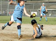 Jessica Hauver steals second base safely during the first game of the Outlaws' doubleheader.