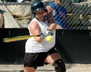 Carolyn McKune rips a base hit.