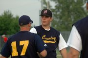 Matt McMillin is congratulated by Cavalry coach Jake Hanson after his outing in the Legion team's season opener.