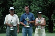 Bob Hovey, left, Gary Ely and Judy Zell hold their trophies after winning their divisions at the first-ever Tri-City Golf Championship.