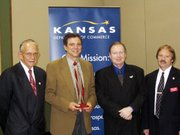 From left, Lansing Mayor Kenneth Bernard, Dick Cameron, Chuck Morrison and City Administrator Mike Smith attend a ceremony Tuesday where Cameron and Morrison, both Lansing business owners, received awards. Two other Lansing businesses also were honored at the ceremony, sponsored by the Kansas Department of Commerce.