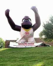 A giant, inflated purple gorilla outside City Hall draws attention to a sign promoting Lansing DAZE. The annual citywide festival runs June 9-12.