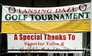 The Lansing DAZE Golf Tournament banner greeted players.