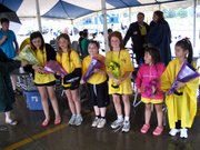 Participants in the first Spirit of Lansing contest receive bouquets of flowers under a tent Saturday at the Lansing DAZE festival. Pictured from left Kelley Searls, Hannah Johnson, Victoria Thompson, Karisa Garber, Kerry Searls and Orion Fairbanks.