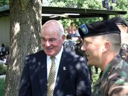 Army Secretary Francis J. Harvey, left, chatted with Lt. Col. Tom Collins and others after the Friday graduation ceremony for the Command and General Staff College at Fort Leavenworth. Harvey was the keynote speaker at the ceremony.