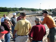 City officials and Lansing City Council members gather around a new aeration basin during a visit to the Wastewater Treatment Plant. The Saturday tour preceded a study session tonight in which the city will lay out its case for higher sewer fees.