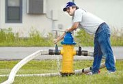 Jesse Green controls the flow from the hydrant that refills the tanker trucks during the water test.