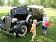 Brynne and Jaxon Qualley, Lansing, find this 1936 Packard convertible to their liking. The brother and sister came out Thursday with their grandparents to look at cars participating in the Veteran Motor Car Club of America's Chrome Glidden Tour. The tour made a stop Thursday afternoon in Lansing.