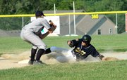 Josh Coleman slides safely into second for a stolen base in the game one victory.