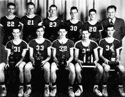 Coach Earl Johnsmeyer, at far left in back row, is pictured with the 1949-50 Lansing High School basketball team, which posted a 29-1 record. The Lansing School Board on Thursday agreed to rename the LHS gym in Johnsmeyer's honor.