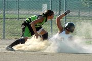 Former Lansing High player Heather Garza puts a tag on Lansing Outlaws player Dana Sanders at third base.