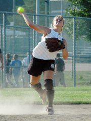 Dana Sanders fires a throw to first base for an out after fielding a ground ball at shortstop.