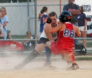 Maggie Aus applies a tag at third base during the Outlaws' 7-4 victory over the Eagles.