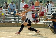 Maggie Aus smashes a line drive at the third baseman in the seventh inning against the KC Impact at the USSSA State Tournament.