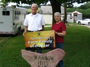 John Sloan and his wife, Marguerite, display their award for Leavenworth County Farm Family of the Year.