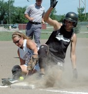 Katie Thompson attempts to tag out a runner at third base during the Lunatics' game against the Southwest Hammers at the AFA National Tournament.