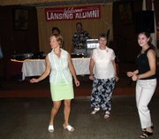 Kelli Abernathy, left, class of 1979, dances with Audrey Sullivan, center, and Sullivan's granddaughter, Courtney Manago, class of 2003. The three were among the first on the dance floor Saturday at the LHS reunion.