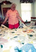 "A quilt maker for nearly half a century, Beverly Jones has little trouble selecting her favorite quilt. It is, Jones said, one she made with other members of a quilting circle at the Texas mobile home park at which she and her husband, Leland, winter. When the finished quilt was won in a drawing by a woman from Canada, Jones decided she would try to buy it. '""I told my husband, 'She's a lovely lady, but I really want that quilt,'"" Jones remembered. ""It was a friendship quilt. One of my best friends died of cancer. We worked on the quilt together. I helped her with her blocks. ""It had very special memories for me."" The Canadian woman was understanding. ""She said, 'No I won't sell it, but you can have it,'"" Jones said. ""She had a house burn down once in Canada, and her neighbors had gotten together and made a quilt for her. She said, 'I take that quilt everywhere; it means so much to me. I know what that quilt means to you.'"" Quilts, Jones said, were the products of a lot of time-consuming work and love. She suspects some of the 34 she's made have the same special meaning to those who now own them. ""I hope so,"" she said. ""I know my farmer's quilt -- I made my two sons farmer's quilts -- mean a lot to my whole family,"" she said. ""I was born and raised on a farm, and for the kids that was the best part of the whole year -- when we could go visit my parents at the farm. We have lots of good memories there."" The farmer's quilts, Jones explained, were quilts with farm scenes made from scraps of the material she had left after making clothes for her two sons and then given to the then-young boys. In the same vein, Jones made Sunbonnet Sue quilts for her two daughters. The quilts were cherished hits, but Jones didn't become a serious quilter until some time later. ""I was busy running a family until the 1970s,"" she said. ""I did more stitching then in the evenings."" As Jones' spare time increased, so did her family. That worked out well. Jones had enough love and time to make quilts for all her sons and daughters, grandchildren and two great-grandchildren. And, she said, she had a few extra for great-grandchildren not yet born. ""I just enjoy doing it,"" she said. ""It's addictive. You go to a fabric shop and see the patterns, you just want to do it yourself."" Books, magazines and quilting stores provide inspiration, as does the quilting circle at the couple's Texas winter home. The group discovered the prairie flower pattern, she said, and even researched its history. Her appreciation didn't lead to snobbery that preferred one pattern or type of pattern over others. ""They all look pretty good to me,"" Jones said. ""It's just if I can decide I can put the work into them. ""There's a lot more to quilting than people realize,"" she said. ""It takes a lot of stitching and a lot of time. ""But that's good when you're retired. You don't have anything but time."""