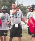 Brad Scott directs his team Monday on the first day of practice. De Soto has improved in each of Scott's five seasons and were league champions a year ago.