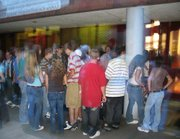 Students wait outside Lansing High School on Friday, Aug. 19, to get into the back-to-school mixer.